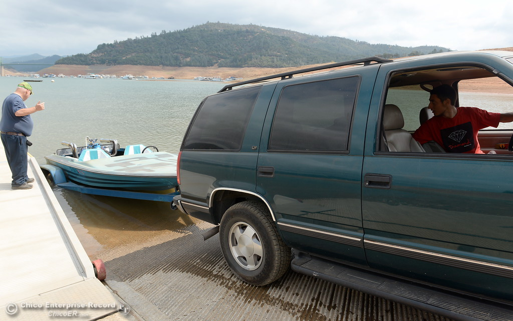 . Wayne Jamison watches as his son Pasha Prokopenko backs in his restored speedboat for it\'s maiden voyage on some new parts at Lake Oroville in Oroville, Calif. Thursday Sept. 14, 2017. (Bill Husa -- Enterprise-Record)