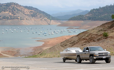 Water levels in Lake Oroville drop closing the primary boat launch at Bidwell Canyon Marina in Oroville, Calif. Thursday Sept. 14, 2017. Another parking lot is located to the left near the bottom of the ramp where a secondary paved boat ramp operates currently. (Bill Husa -- Enterprise-Record)