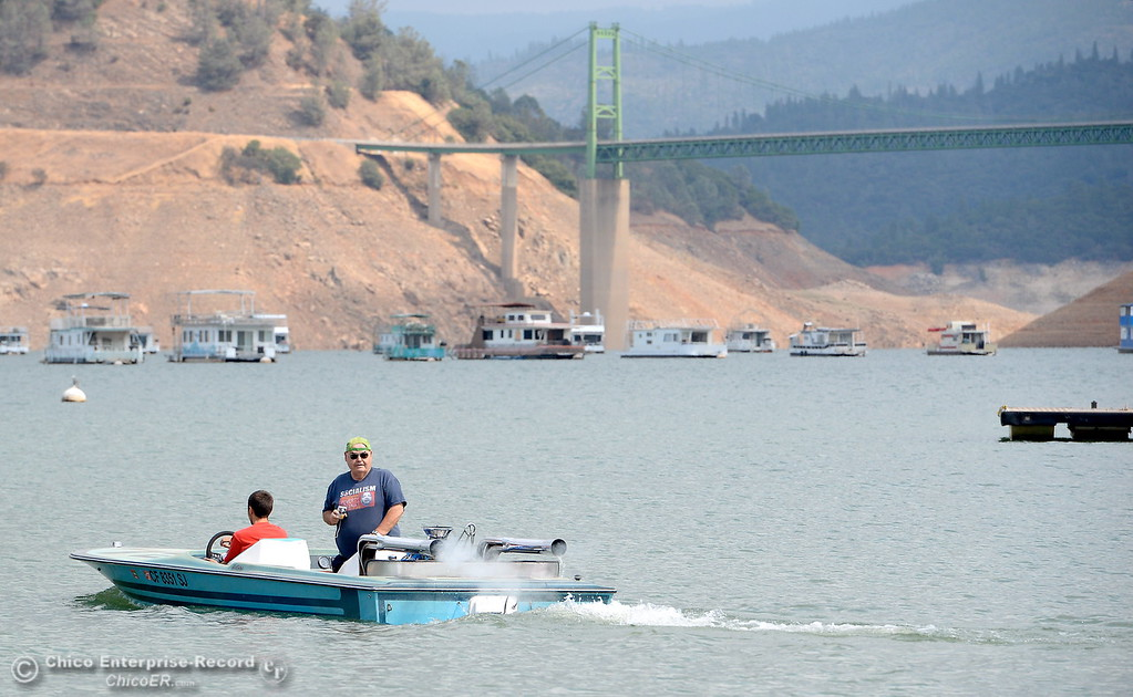 . Pasha Prokopenko takes a test drive, maiden voyage in his restored speedboat with Wayne Jamison in Oroville, Calif. Thursday Sept. 14, 2017. (Bill Husa -- Enterprise-Record)