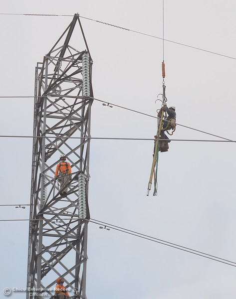 Fearless PG&E Linemen are plucked from a tower by a helicopter as work continues near the Lake Oroville Dam Spillway in Oroville, Calif. Thursday Sept. 14, 2017. (Bill Husa -- Enterprise-Record)