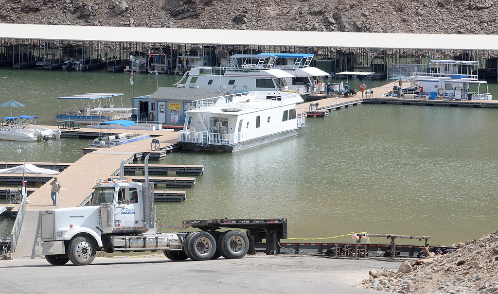 . A truck is seen near the bottom of the boat ramp as houseboats are pulled from Lake Oroville at Forever Resorts Lime Saddle Marina Monday Sept. 18, 2017. (Bill Husa -- Enterprise-Record)