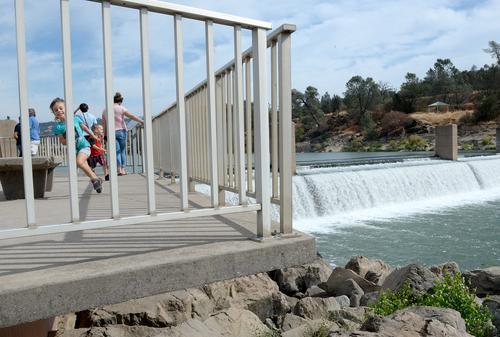 . Children play while parents watch for fish jumping near the Fish Barrier Dam Monday Sept. 18, 2017. The Feather River Fish Hatchery Salmon Ladder and viewing area opened today. (Bill Husa -- Enterprise-Record)