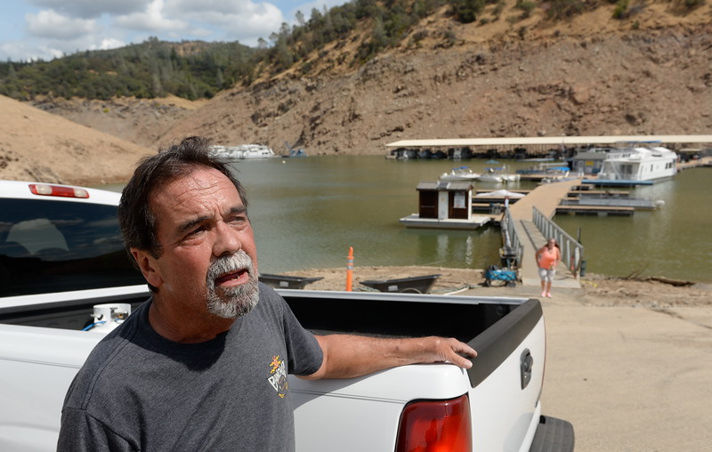 Houseboat owner Dave McKim said he intends to leave his boat in the lake for the winter as some houseboats are pulled out of Lake Oroville at Forever Resorts Lime Saddle Marina Monday Sept. 18, 2017. (Bill Husa -- Enterprise-Record)