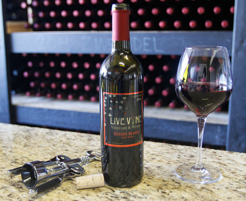. A bottle of Live Vine Wine opened and ready to drink September 22, 2017 in Oroville, California. (Emily Bertolino -- Mercury Register)