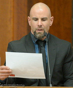 Detective Dane Gregory looks at a photo of the victim as he testifies during a preliminary hearing in the case of Marc Valcarenghi at Butte County Superior Court in Oroville, Calif. Tues. Aug. 29, 2017. Valacarenghi is accused of a homicide at the Safari Inn. (Bill Husa -- Enterprise-Record)