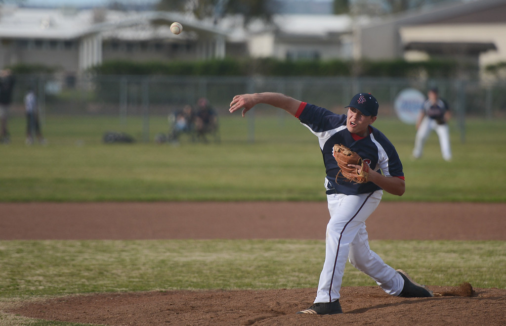 . Las Plumas High\'s Mason Whitfield pitches the ball, March 29, 2018, in Oroville, California. (Carin Dorghalli -- Enterprise-Record)