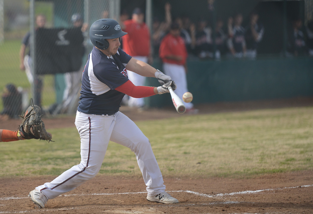 . Las Plumas High\'s Nick Greer hits the ball, March 29, 2018, in Oroville, California. (Carin Dorghalli -- Enterprise-Record)