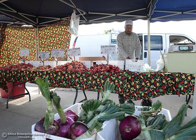 Gurvip Gill, of Dhillon Farms, sorts produce at the Oroville Certified Farmers Market's new location Saturday, May 14, 2016, at Riverbend Park in Oroville, California. (Dan Reidel -- Enterprise-Record)