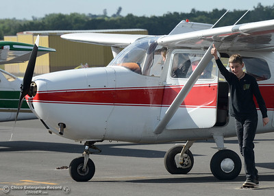 Ryan Wilhelm, 11, of Oroville, gives a thumbs-up after a flight Saturday, May 14, 2016, at the Oroville Airport in Oroville, California. (Dan Reidel -- Enterprise-Record)