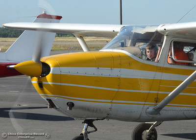 Rodney Hammac, 9, of Oroville, and pilot Chuck Topalian, a flight instructor for Table Mountain Aviation, prepare to fly Saturday, May 14, 2016, in Topalian's Cessna 172E at the Oroville Airport in Oroville, California. (Dan Reidel -- Enterprise-Record)