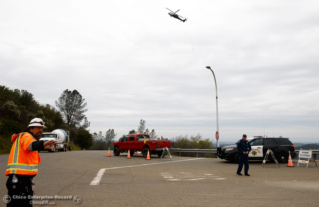 . Helicopters and cement trucks are seen Wednesday as the Lake Oroville Dam Spillway emergency continues in Oroville, Calif. Wed. Feb. 15, 2017. (Bill Husa -- Enterprise-Record)