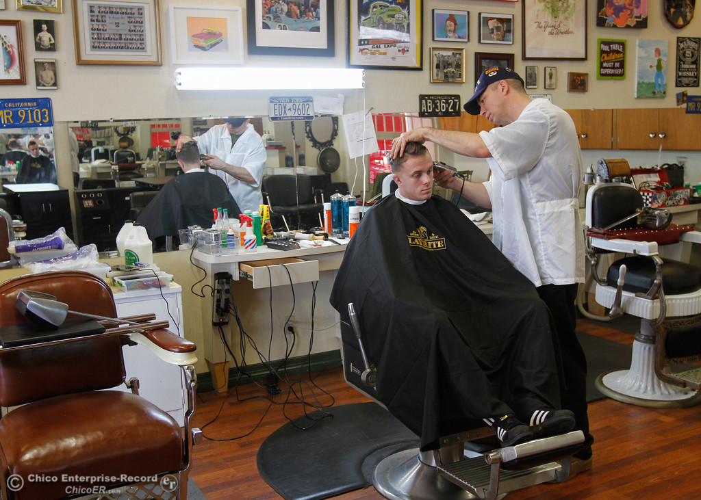 . David Edwards gives Lake Gee a haircut at Gearhead Barbershop as residents come back into town and businesses reopen after the mandatory evacuation February 15, 2017 in Oroville, California. (Emily Bertolino -- Enterprise-Record)