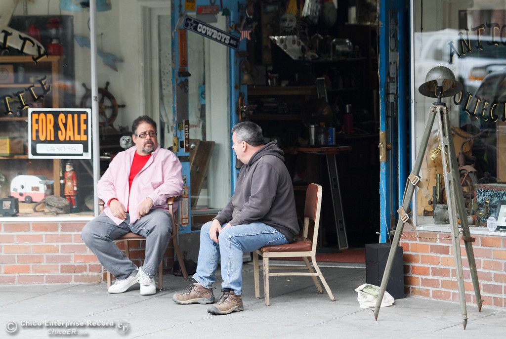 . Andy Suplita and Devin McDonnell sit in front of Suplita\'s downtown business Gold City Mercantile as residents arrive and businesses reopen after the mandatory evacuation order February 15, 2017 in Oroville, California. (Emily Bertolino -- Enterprise-Record)