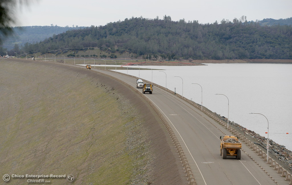 . Trucks, helicopters and many different agencies work together as the Lake Oroville Dam Spillway emergency continues in Oroville, Calif. Wed. Feb. 15, 2017. (Bill Husa -- Enterprise-Record)