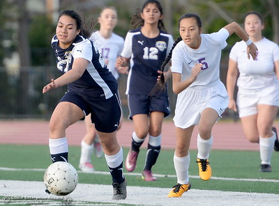 Gridley #27 Susie Orozco and Oroville #5 Sen Thao race for the ball during first half action of Oroville vs Gridley girls soccer at Harrison Stadium in Oroville, Calif. Tues. Jan. 23, 2018. Bill Husa -- Enterprise-Record)