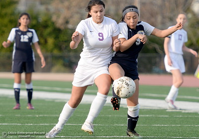 The battle of the 9's, Oroville's Leann (Nevech) Wood and Gridley's Valeria Rodarte is an exciting one to watch during  first half action of Oroville vs Gridley girls soccer at Harrison Stadium in Oroville, Calif. Tues. Jan. 23, 2018. Bill Husa -- Enterprise-Record)