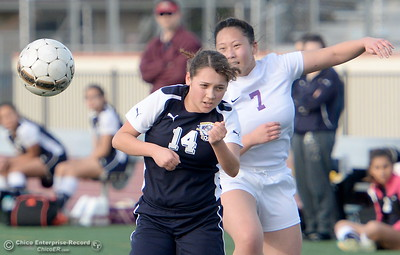 Gridley #14 Jazlyn Guiterrez battles with Oroville #7 Gabby Vang during first half action of Oroville vs Gridley girls soccer at Harrison Stadium in Oroville, Calif. Tues. Jan. 23, 2018. Bill Husa -- Enterprise-Record)