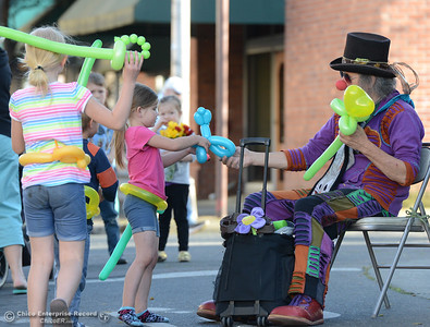 Staci Ripperger, 6, gets a balloon animal from the clown during the Historic Downtown Oroville Certified Farmers Market on Wednesday, March 30, 2016, on  Myers Street in Oroville, California. (Dan Reidel -- Mercury-Register)