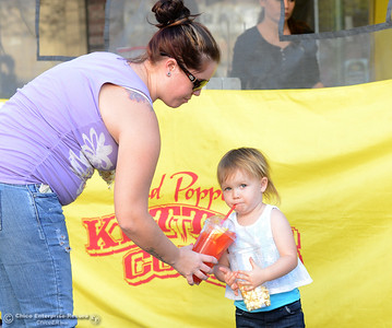 Tara Owens gives her daughter Jennavae, 2, a sip from a drink bought at Baker's Choice Kettle Corn during the Historic Downtown Oroville Certified Farmers Market on Wednesday, March 30, 2016, on  Myers Street in Oroville, California. (Dan Reidel -- Mercury-Register)