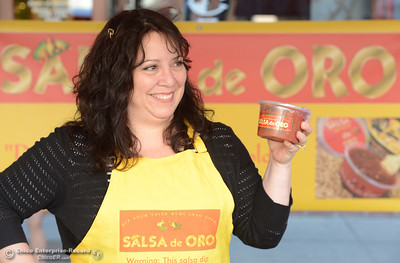 Elizabeth Rodriguez holds up a package of her salsa at the Salsa de Oro booth during the Historic Downtown Oroville Certified Farmers Market on Wednesday, March 30, 2016, on  Myers Street in Oroville, California. (Dan Reidel -- Mercury-Register)