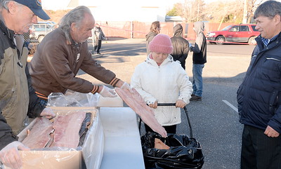 "Ellena and Fiodor Todiras at right smile as they receive salmon fillets being handed out during the Salmon giveaway at the Enterprise Rancheria in Oroville, Calif. Thurs. Dec. 29, 2016. Ellena said ""We need it."" (Bill Husa -- Enterprise-Record)"