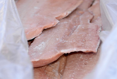 10,000 lbs. of frozen salmon fillets are handed out during the Salmon giveaway at the Enterprise Rancheria in Oroville, Calif. Thurs. Dec. 29, 2016. (Bill Husa -- Enterprise-Record)