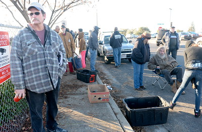 "First in line at left is Mike Nobel as roughly 130 people line up to receive some of the 10,000 lbs. of salmon fillets behing handed out during the Salmon giveaway at the Enterprise Rancheria in Oroville, Calif. Thurs. Dec. 29, 2016. Nobel said he had been receiving the fish for ""at least five years"" and that he was in line at 7:00 a.m. this morning. (Bill Husa -- Enterprise-Record)"