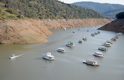 Houseboats are seen as the water slowly rises at Lake Oroville near the Forever Resorts Limesaddle Marina Tues. Dec. 27, 2016.