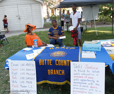 "Irma Jordan, LaJuana Powell and Bryn Smith at the NAACP, National Association for the Advancement of Colored People, booth at the annual National Night Out, a ""community-building campaign that promotes police-community partnerships and neighborhood camaraderie to make our neighborhoods safer, better places to live"" August 2, 2016 at the Lott Home in Oroville, Calif. (Emily Bertolino -- Mercury Register)"