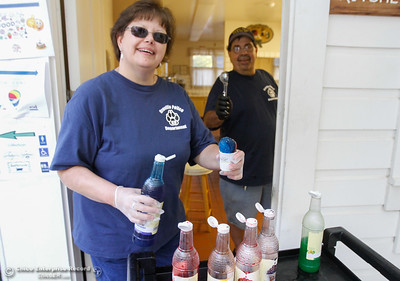 Oroville VIPS Gretchen Myers and Jim Segneri hand out snow cones at the annual National Night Out August 2, 2016 at the Lott Home in Oroville, Calif. (Emily Bertolino -- Mercury Register)
