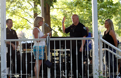 Mayor Linda Dahlmeier swears in new officer Joel Deal to the Oroville Police Department at the annual National Night Out August 2, 2016 at the Lott Home in Oroville, Calif. Deal served in law enforcement for 20 years, with the Butte County Sheriffs for 15 and is now joining the Oroville Police Department. (Emily Bertolino -- Mercury Register)