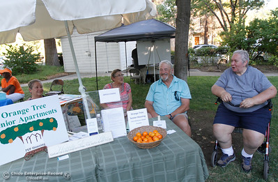 A group of friends who live at the Orange Tree Senior Apartments talk about how much they like it there and promote the complex at the annual National Night Out August 2, 2016 at the Lott Home in Oroville, Calif. (Emily Bertolino -- Mercury Register)