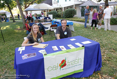 Taryn Fortunati and Anthony Hiseley with the Chico State Center for Healthy Community program promote the Cal Fresh program at the annual National Night Out August 2, 2016 at the Lott Home in Oroville, Calif. (Emily Bertolino -- Mercury Register)