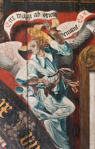 Münster, Dom, astronomische Uhr, Zwickel des Ziffernblatts, Symbol des Evgl. Matthäus (Ludger tom Ring d.Ä.)