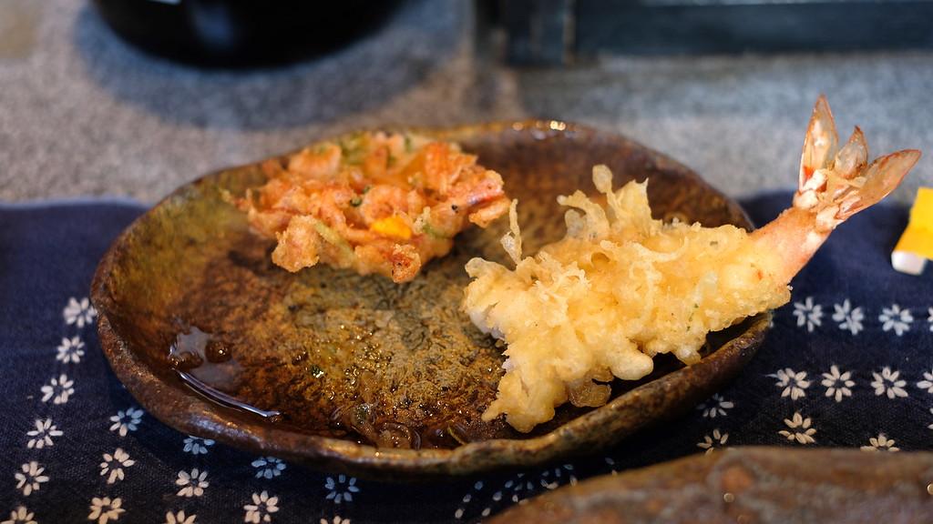 Prawn tempura and half a fritter.
