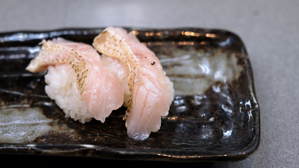 Two pieces of nodoguro sushi.