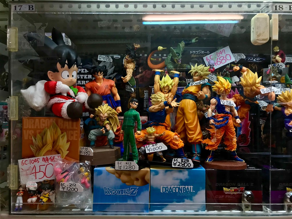 Collectible figurines in a glass case.