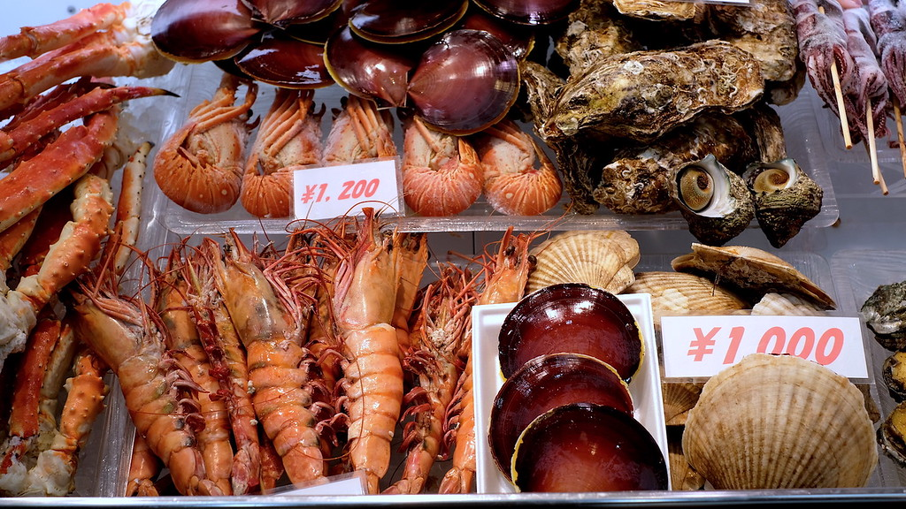 Seafood displays in Kuromon Market.