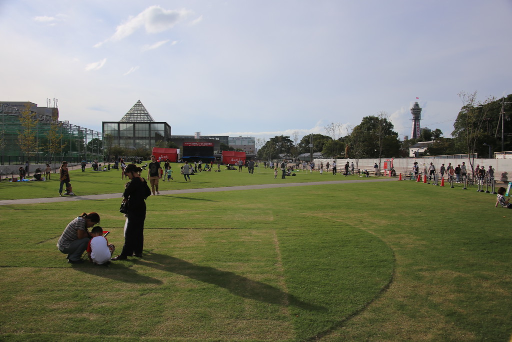 The lawn at Tennoji Park, with an early work of Tadao Ando in the background.