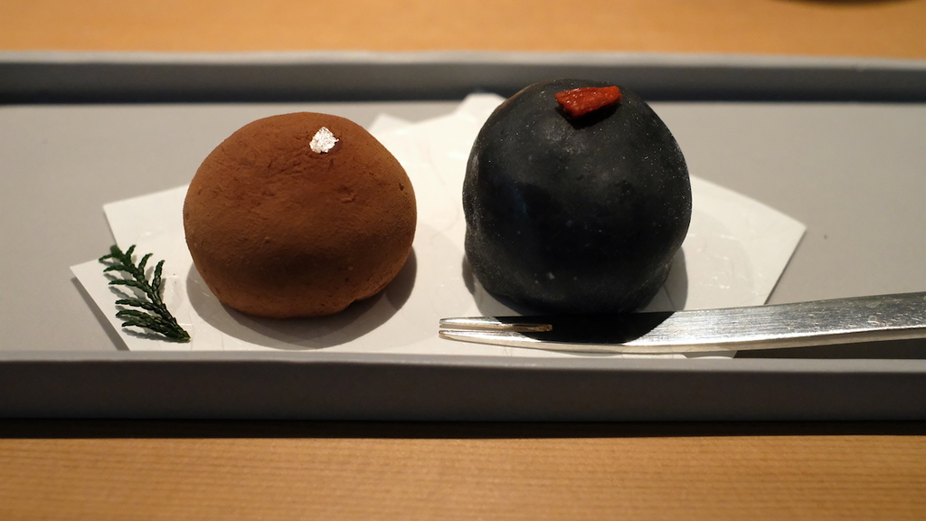 A pair of daifuku mochi – chocolate and black bean.