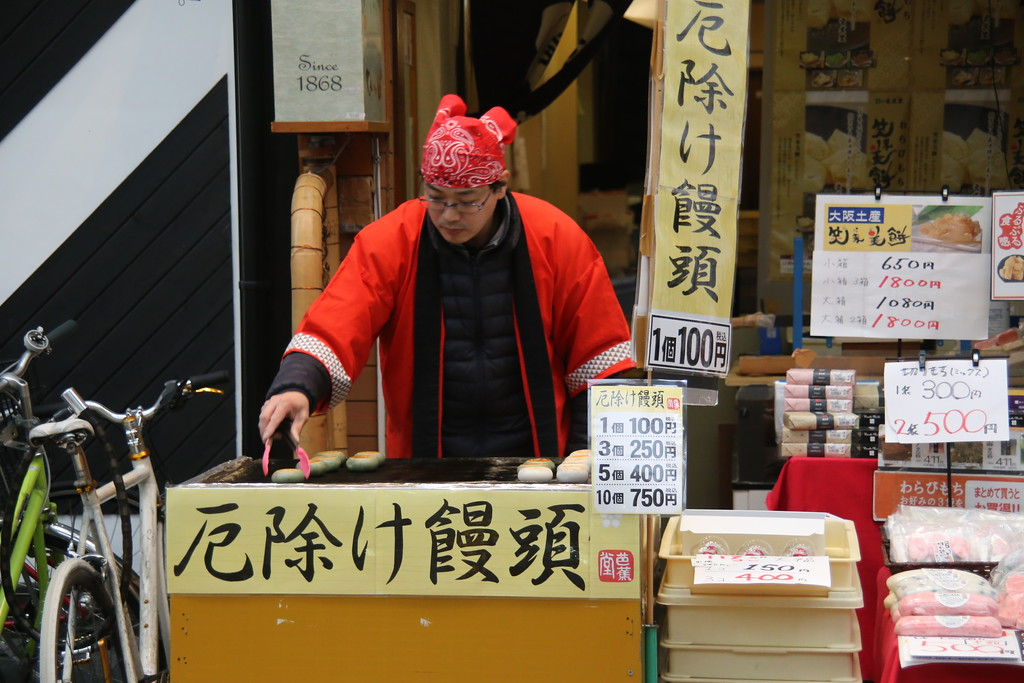 man cooking good luck rice cakes