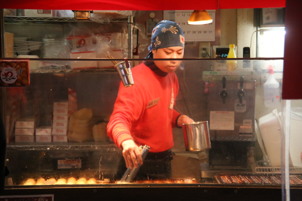man preparing takoyaki