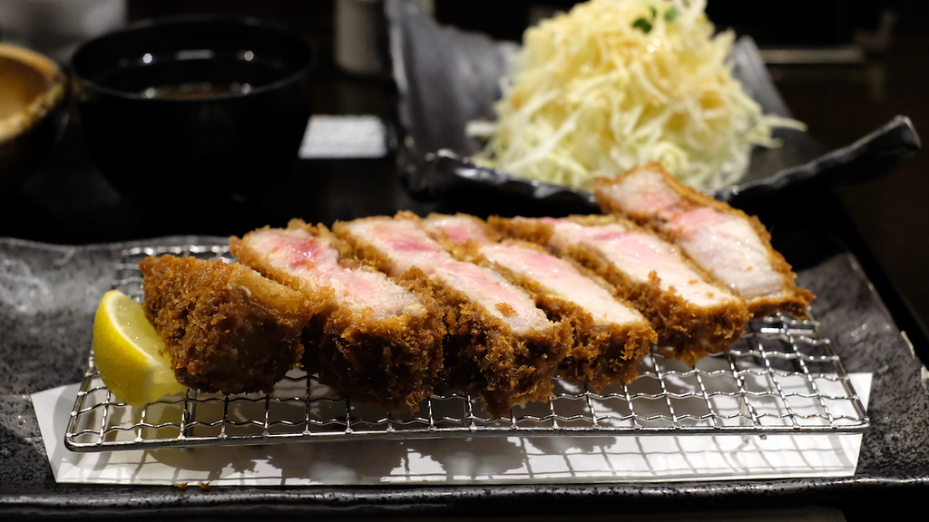 Pink-streaked centers in the fried pork cutlet.