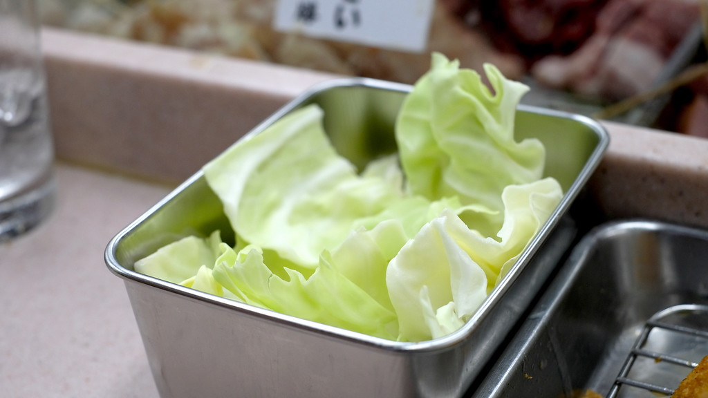 Free cabbage! Dip in the sauce for a refresher between deep-fried food.