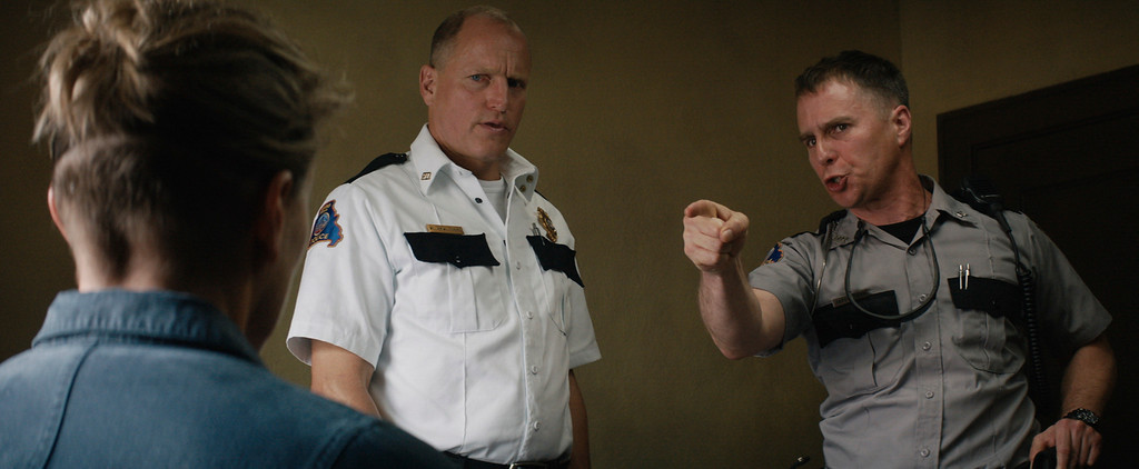 ". This image released by Fox Searchlight Pictures shows Woody Harrelson, center, and Sam Rockwell in a scene from ""Three Billboards Outside ebbing, Missouri.\""  Harrelson and Rockwell were nominated for an Oscar for best supporting actor on Tuesday, Jan. 23, 2018. The 90th Oscars will air live on ABC on Sunday, March 4. (Fox Searchlight Pictures via AP)"