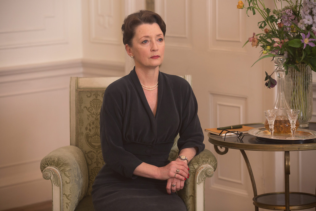 ". In this image released by Focus Features, Lesley Manville appears in a scene from ""Phantom Thread.\""  Manville was nominated for an Oscar for best supporting actress on Tuesday, Jan. 23, 2018. The 90th Oscars will air live on ABC on Sunday, March 4. (Laurie Sparham/Focus Features via AP)"