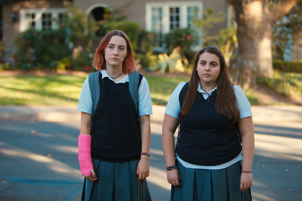 ". FILE - This file image released by A24 Films shows Saoirse Ronan, left, and Beanie Feldstein in a scene from ""Lady Bird.\"" Ronan says she hopes that her latest film �Lady Bird� helps people to feel understood in the same way HBO show �Girls� helped her. Her performance has earned her some of the best reviews of her career and could result in a third Oscar nomination for the 23-year-old Irish actress. (Merie Wallace/A24 via AP, File)"