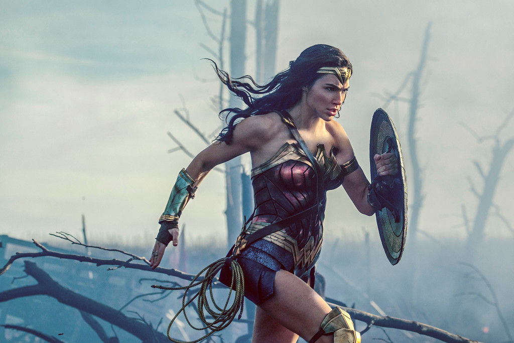 ". This image released by Warner Bros. Entertainment shows Gal Gadot in a scene from ""Wonder Woman.\""  The Patty Jenkins-directed blockbuster received zero Oscar nominations Tuesday, Jan. 23, 2018, even in a year that was surprisingly friendly to big budget hits. (Clay Enos/Warner Bros. Entertainment via AP)"