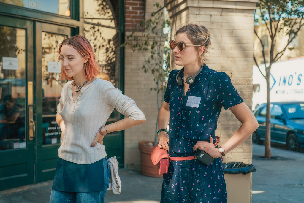 ". This image released by A24 Films shows director Greta Gerwig, right, and Saoirse Ronan on the set of ""Lady Bird.\"" Gerwig is expected to be the fifth woman nominated for an Oscar for best director when the nominations for the 90th annual Academy Awards are announced on Tuesday.  (Merie Wallace/A24 via AP)"