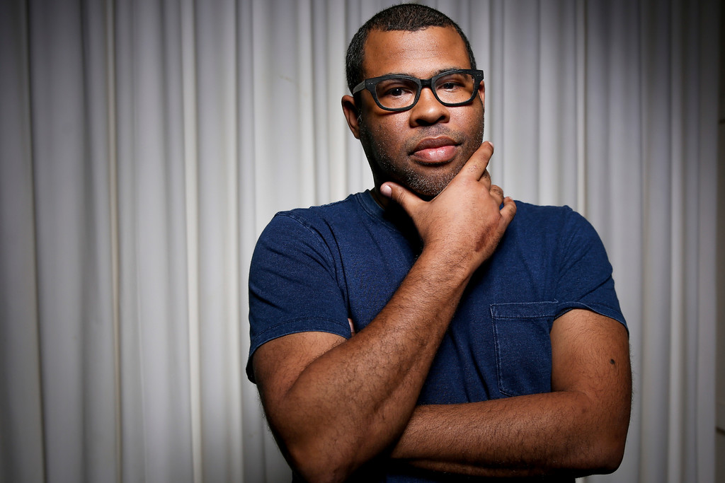 ". FILE - In this Feb. 9, 2017 file photo, Jordan Peele poses for a portrait to promote his film, ""Get Out,\"" in Los Angeles. Peele was nominated for an Oscar for best original screenplay as well as best director on Tuesday, Jan. 23, 2018. The 90th Oscars will air live on ABC on Sunday, March 4.(Photo by Rich Fury/Invision/AP, File)"